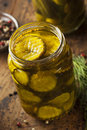 Homemade organic crunch green pickles in a jar Stock Photo