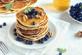 Homemade pancakes with blueberry honey and walnuts for breakfast Stock Photography