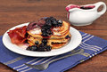 Homemade pancakes with fresh blueberry sauce and bacon. Royalty Free Stock Photo