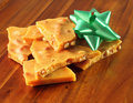 Homemade Peanut Brittle with Green Bow Stock Photography