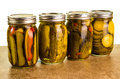 Homemade pickles in mason jars on a kitchen counter Royalty Free Stock Photography