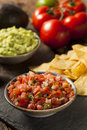 Homemade pico de gallo salsa and chips ready to eat Stock Photos