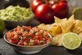 Homemade pico de gallo salsa and chips ready to eat Stock Photo