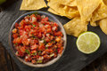 Homemade pico de gallo salsa and chips ready to eat Stock Image