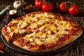 Homemade Pineapple and Ham Hawaiian Pizza Royalty Free Stock Photo