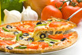 Homemade pizza fresh tomato olive mushroom cheese Stock Images