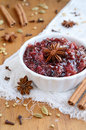 Homemade plum chutney and spices cinnamon truestar anise cloves cardamom coriander seeds Stock Images