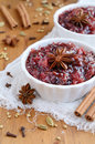 Homemade plum chutney and spices cinnamon truestar anise cloves cardamom coriander seeds Stock Image