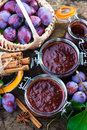 Homemade plum jam with freshly picked plums on wooden table Royalty Free Stock Images