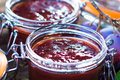 Homemade plum jam with freshly picked plums on wooden table Stock Photo