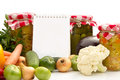 Homemade preserves with fresh vegetables empty paper for recipe Royalty Free Stock Photos