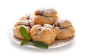 Homemade profiteroles with chocolate cream and powdered sugar Royalty Free Stock Images
