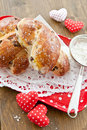 Homemade raisin buns with raisins on red dotted tray Stock Image