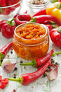 Homemade red hot chilli sauce in the glass jar Stock Image
