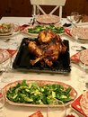 Homemade Roasted Thanksgiving Day Turkey with all the Sides at Dinner Table. Royalty Free Stock Photo