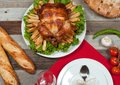 Homemade  roasted whole turkey on wooden table for Thanksgiving. Royalty Free Stock Photo