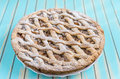Homemade rustic apple tart pie on dish over wooden turquoise background