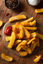 Homemade salty steak french fries with ketchup Royalty Free Stock Image