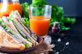 Homemade sandwich with salad and juice as a healthy breakfast Royalty Free Stock Photo