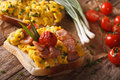 Homemade sandwich with scrambled eggs, bacon and tomatoes close- Royalty Free Stock Photo