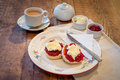 Homemade scones with jam and clotted cream landscape format picture of typically english afternoon tea home made strawberry set on Stock Photos