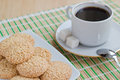 Homemade sesame seed cookies and cup of coffee Royalty Free Stock Photos