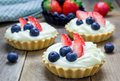 Homemade shortbread tartlets with custard cream, strawberry and blueberry Royalty Free Stock Photo