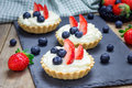 Homemade shortbread tartlets with custard cream, strawberry,  blueberry Royalty Free Stock Photo
