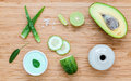 Homemade skin care and body scrub with natural ingredients avocado ,aloe vera ,lime,cucumber and honey set up on wooden Royalty Free Stock Photo