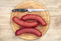 Homemade smoked sausage on a cutting board top view Royalty Free Stock Photo