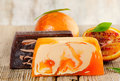 Homemade soap with fresh orange on a wooden table Royalty Free Stock Photography