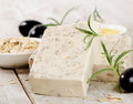 Homemade soap with oat meal and olives on a wooden table selective focus Stock Image