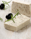 Homemade soap with olives and herbs Stock Photo