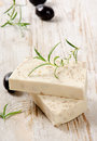 Homemade soap with olives and herbs on a wooden table Stock Photo