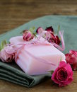 Homemade soap with roses on a wooden table Royalty Free Stock Photos