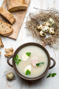 Homemade soup with eggs and sausage closeup of on old wooden table Royalty Free Stock Photos