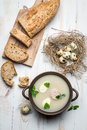 Homemade soup with eggs and sausage on old wooden table Stock Image
