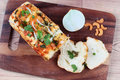 Homemade spinach bread with halves onion and cashew nuts on butcher served Royalty Free Stock Photo