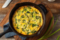 Homemade spinach and feta fritatta in a skillet Royalty Free Stock Photo