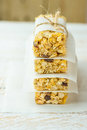 Homemade stacked muesli cereal bar with oats, nuts, raisins, honey and dried apples. Lined with parchment paper, tied with twine Royalty Free Stock Photo