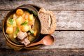 Homemade stew soup with vegetables and beef ribs in the rustic bowl selective focus and blank space Royalty Free Stock Photography