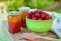 Homemade strawberry jam in different jars and fresh ripe strawbe apricot strawberries summer Stock Photo