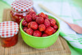 Homemade strawberry jam in different jars and fresh ripe strawbe strawberries summer Stock Images