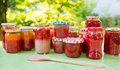 Homemade strawberry jam in different jars gooseberry and apricot Royalty Free Stock Photos