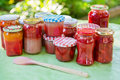 Homemade strawberry jam in different jars gooseberry and apricot Royalty Free Stock Photography