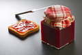 Homemade strawberry jam jar rusk jam silver knife Royalty Free Stock Photography