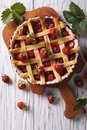 Homemade strawberry tart in a baking dish vertical top view Royalty Free Stock Photo