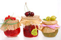 Homemade summer fruit preserves jars of on white Stock Photo