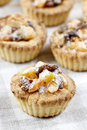 Homemade tarts with dried fruits on checked table cloth festive and party dessert Royalty Free Stock Image