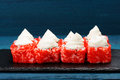 Homemade tasty sushi with red tobiko roe and cream cheese on blu Royalty Free Stock Photo